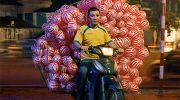 Жизнь мотоциклистов со службы доставки во Вьетнаме: впечатляющие фото